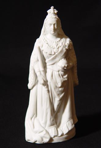 A small statue of queen Victoria in white ceramic.